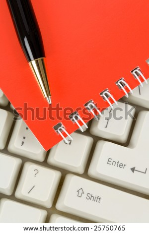 Red Note Pad and Keyboard close up