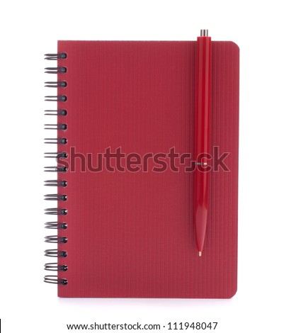 Red notebook with  pen isolated on white background cutout