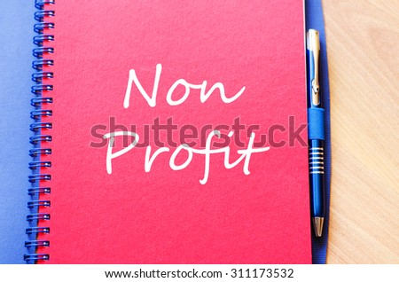 Red notepad and Non profit text concept