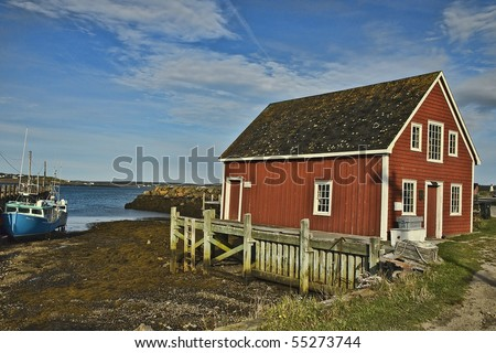 Red Nova Scotia Boat House and Boat at Briers Island on the Bay of Fundy