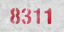 Red Number 8311 on the white wall. Spray paint. Number eight thousand three hundred and eleven.