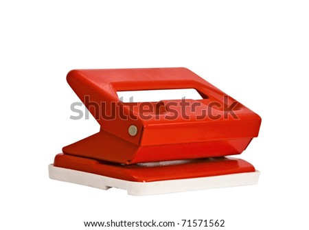Red office hole punch on a white background