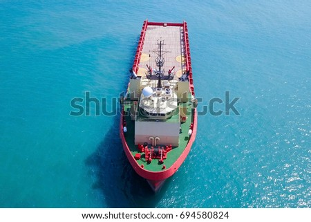 Red Offshore supply ship at sea - Aerial image