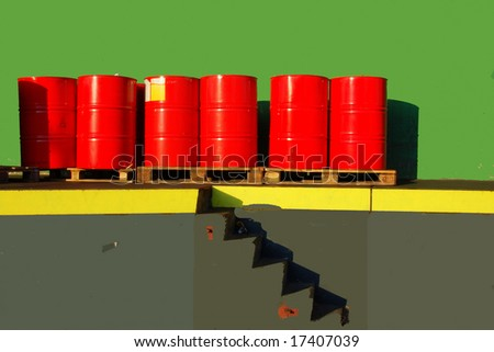 Red oil drums on a shipping ramp