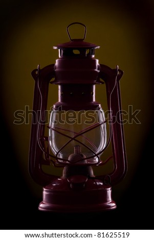 Red oil lamp on a dark Yellow background