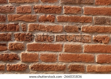 Red old brick wall texture as a background