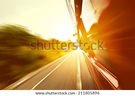 Red old bus going fast on the highway with motion blur background #211805896