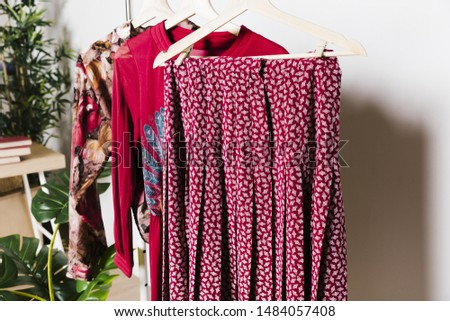 Red old clothes on hangers  #1484057408