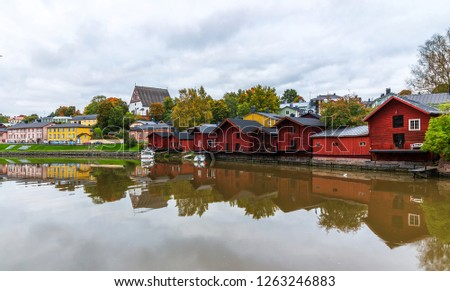 Red old wooden houses on the riverbank of Porvoo river. Old town of Porvoo in Finland