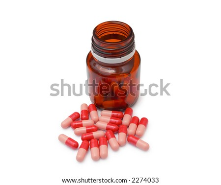 Red Omeprazol pills next to pill bottle