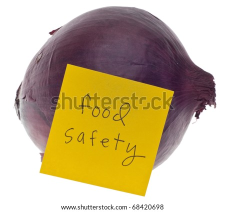 Red Onion and Note Saying Food Safety Isolated on White with a Clipping Path.