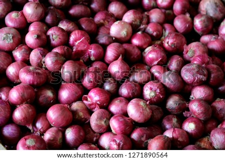 Red onion on the market close up food background #1271890564