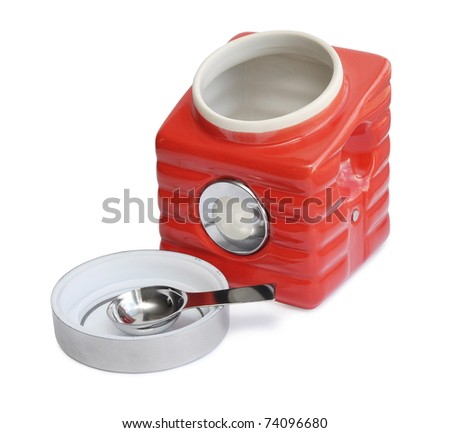 Red open decorative jar over the white background