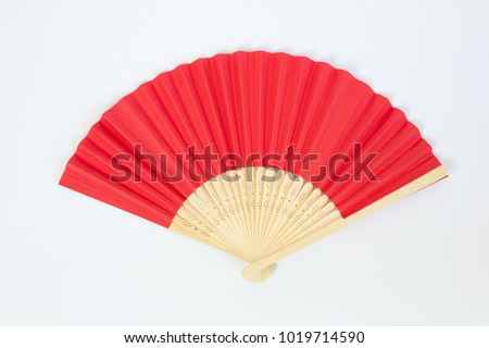Red Open Hand Fan Isolated on a White Background. #1019714590