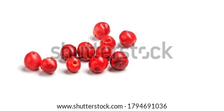 Red or pink peppercorns on board, closeup photo isolated with white background Stock photo ©