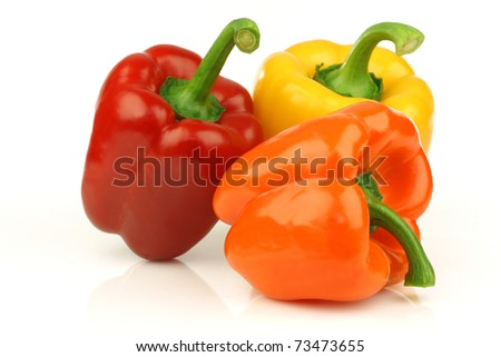 red, orange and yellow bell pepper(capsicum) on a white background