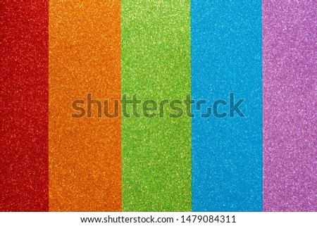 Red, orange, green, blue, purple glitter. Abstract shiny colorful background. A set of texture paper for decoration and design of Christmas, New Year or other holiday pictures. Beautiful packaging