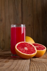 Red orange juice on wooden table