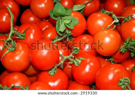 Red organic baby tomatoes on the market