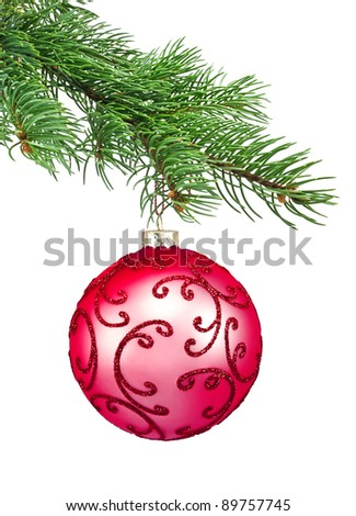 Red ornament christmas ball in a fir tree on a white background