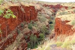 Red oxide sedimentary cliffs decent into deep gorge