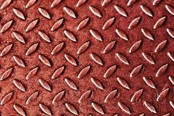 Red paint metal sheet. Metal grid walkway. Grunge steel mesh texture. Heavy iron backdrop pattern. Industrial grate design background. Anti slip metal matt texture.