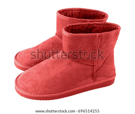 Red pair of short winter u g g boots isolated white #696514255