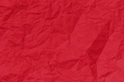 Red paper backround. Red crumpled paper texture. Red crumpled paper texture. Red wrapping paper as Christmas background