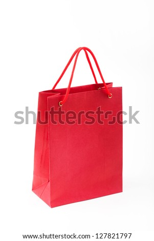 Red paper bag closeup  on white background