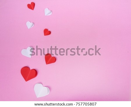 Red paper heart isolated on pink background with copy space #757705807