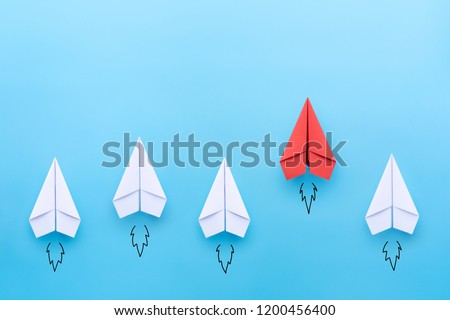 Red paper plane leading among a white planes on blue background. Business competition and Leadership concept Stock photo ©