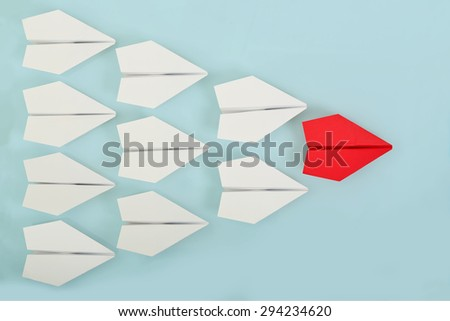 red paper plane leading white ones, leadership concept Stock photo ©