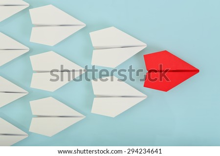 red paper plane leading white ones, leadership concept