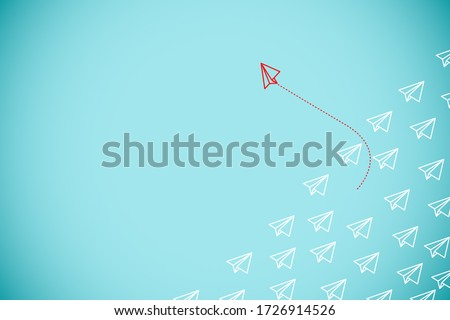 Red paper plane out of line with white paper to change disrupt and finding new normal way on blue background. Lift and business creativity new idea to discovery innovation technology.