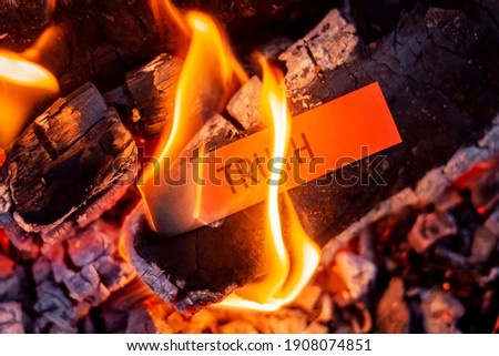 Red paper with inscription Truth burning in the fire. Hiding truth, telling a lie symbol ストックフォト ©