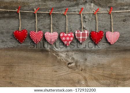 Red patterned  Valentine's hearts hanging on rustic Elm wooden texture background, copy space Stock fotó ©