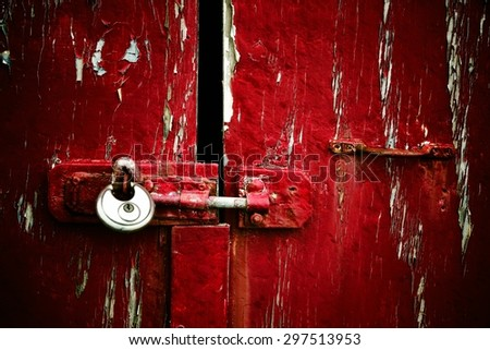 Red peeling paint with padlock