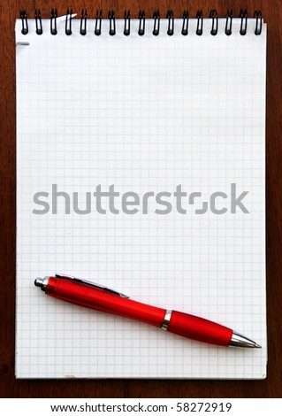 Red pen and Spiral Notebook