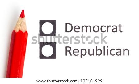 Red pencil choosing between democrat and republican (election America) - stock photo