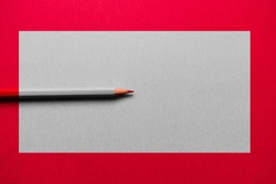 Red pencil over a red background, with a grey rectangle in the middle. The pencil is desaturated in the rectangle, except for its tip