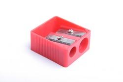 Red pencil sharpner on white background