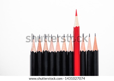 Red pencil standing out from crowd of identical black pencils on white background, be leader and unique, independence, initiative, strategy, the one think different, business success concept #1431027074