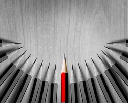 Red pencil standing out from crowd of plenty identical black fellows on white table. Leadership, uniqueness, independence, initiative, strategy, dissent, think different, business success concept