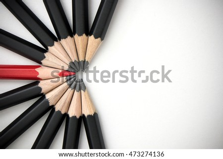 Shutterstock Red pencil standing out from crowd of plenty identical black fellows on white table. Leadership, uniqueness, independence, initiative, strategy, dissent, think different, business success concept