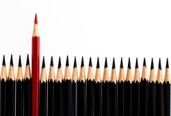 Red pencil standing out from the crowd on white background.