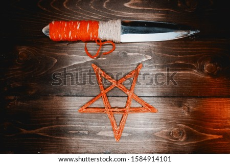 Red pentagram and ritual knife
