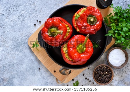 Red pepper stuffed with meat, bulgur and vegetables in a cast-iron pan. Baked stuffed peppers. Stock photo ©