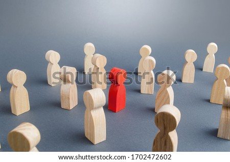 Red person in a crowd of people. Complexity/difficulty of determining/defining of infected person. High risk to spread disease viruses. Violations of self-isolation and disastrous consequences. Stock photo ©