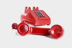 Red phone with the handset off the hook