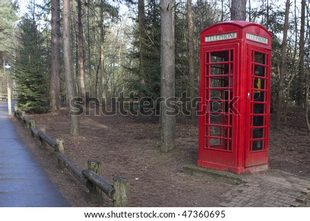 red phonebox in countryside in suffolk, uk